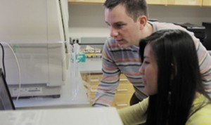 Ryan Jensen and Tiffany Nguyen examining gel images with the ChemiDoc MP imager