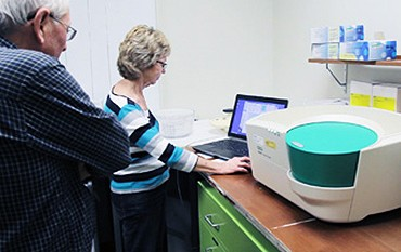 Researchers poring over data from Bio-Rad's droplet reader for absolute DNA quantification